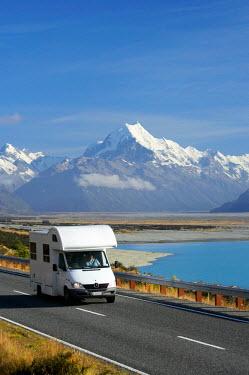 AU02_DWA1940_M Campervan on road to Aoraki / Mt Cook, and Lake Pukaki, Canterbury, South Island, New Zealand