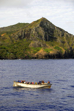 OC10_CMI0000_M South Pacific, British Overseas Teritory, Pitcairn Island. With only 50 residents, Pitcairn is notable for being the least polulated jurisdiction in the world. Local residents in long boat.