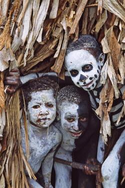 OC12_KSU0095_M Omo Masilai skeleton boy in the village, Omo Masilai Village, Goroka, Papua New Guinea