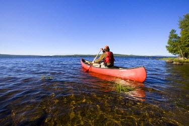 US20_JMO1058_M Canoeing on Maine's Brassua Lake.  Near Moosehead Lake, owned by Plum Creek. (MR)
