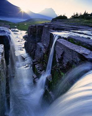US27_CHA0014_M Triple Waterfall at Logan Pass in Glacier National Park in Montana