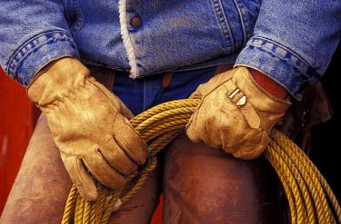 US38_DGU0062_M USA, Oregon, Seneca, Ponderosa Ranch, Cowboy and his rope,  (MR)