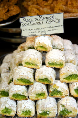 EU16_CMI0334_M Italy, Sicily, Taormina. Typical Sicilian dessert, lemon pastry covered in powered sugar.
