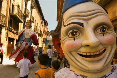 EU27_JMI0063_M Three large portable man-carried statues Fiestas de la Juventud in Puente de Reine village, Navarra, Spain.