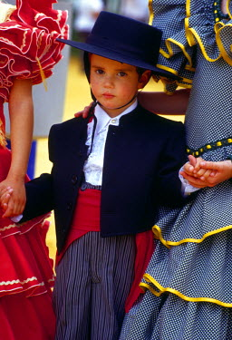 EU27_JME0134_M Spain, Andalucia, Seville Boy (3 yrs) in traditional clothes at annual Feria de Abril (April Fair)