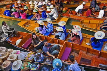 Thailand.The bustling floating market at Damnern Saduak, 80 km southwest of Bangkok, has been in existence since 1872.