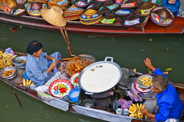 Thailand. A food seller at the bustling floating market at Damnern Saduak, 80 km southwest of Bangkok, which has been in existence since 1872.