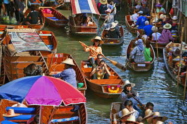 Thailand. A very busy canal, or khlong, at the bustling floating market at Damnern Saduak, 80 km southwest of Bangkok, which has been in existence since 1872.