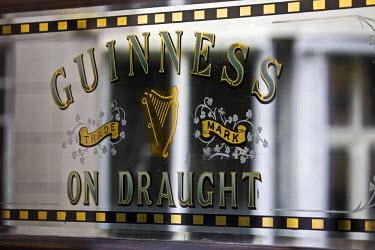 IRL0046 Ireland, Dublin, Portobello, Guinness Draught sign on the doors of the Bleeding Horse pub.