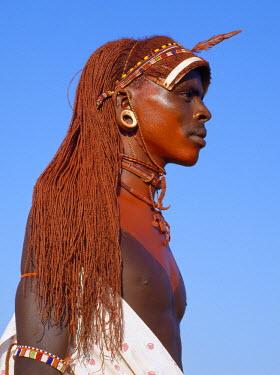 KEN6281 A Samburu warrior in traditional dress with long ochred hair.