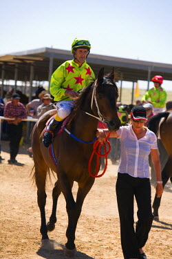 AUS1047 Australia, Queensland, Birdsville.  Horse and jockey at the annual Birdsville Cup Races.  Every September thousands of visitors arrive in the remote town for the most famous horse racing carnival in o...