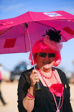 AUS1048 Australia, Queensland, Birdsville.  A woman in costume dress for the fun of the Birdsville Races.  Every September the remote town hosts the Birdsville Cup, the most famous horse racing carnival in ou...