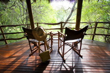 SAF5853 South Africa; North West Province; Madikwe Game Reserve. Canvas safari chairs on the private balcony of a cottage at Jaci's Safari Lodge.