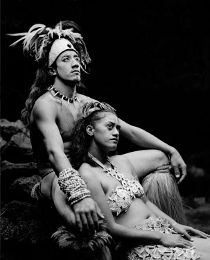 CHI8915 A Rapanui man and woman in traditional costume photographed at Te Pahu caves (MR)