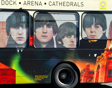 """ENG9395AW �Beatles"""" famous four on a bus in Liverpool, Merseyside, UK"""