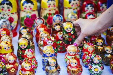 LIT1144AW Lithuania, Vilnius, Woman Holding Souvenir Russian Doll (MR)