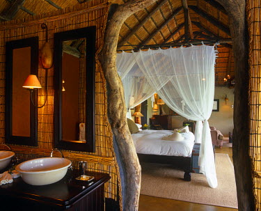 SAF3733 South Africa, Mpumalanga, Sabi Sands Game Reserve.  A luxurious bedroom at Leopard Hills.