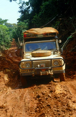 DRC1017 Democratic Republic of Congo.  A landrover battles its way through the mud on the main west to east trade route through Congo.