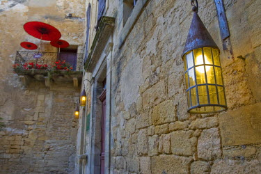 FRA6669AW A balcony and lantern in Sarlat France