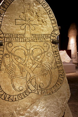 SWE1128 Sweden, Island of Gotland, Visby. Detail from Viking carved rune stones in the Historical Museum of Gotland showing characteristic interlocking patterns.