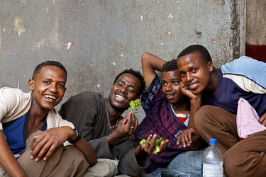 ETH2457 Ethiopia, Harar. A group of young men enjoying the effects of local stimulant Chat.