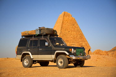 SUD1147 Sudan, Karima. A 4x4 parked by the pyramids at Karima.