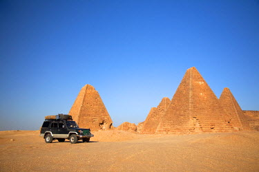 SUD1148 Sudan, Karima. A 4x4 parked by the pyramids at Karima.
