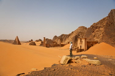 SUD1156 Sudan, Begrawiya. A tourist explores the ancient Nubian Pyramids.