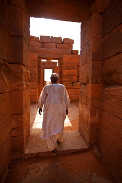 SUD1167 Sudan, Nagaa. The solitary guide at the remote ruins of Nagaa walks through the ruins.