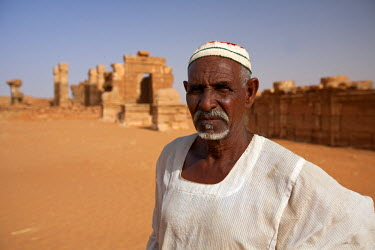 SUD1169 Sudan, Nagaa. The solitary guide at the remote ruins of Nagaa stands in front of the ruins.