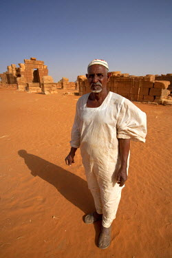 SUD1170 Sudan, Nagaa. The solitary guide at the remote ruins of Nagaa stands in front of the ruins.