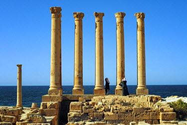 LIB1252 Libya, Sabratha. Arab tourists taking photographs.