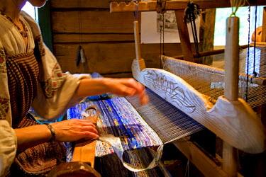 RUS1470 Russia, Leningrad Region, Podporozhsky. In Mandrogi, a crafts village on the Svir river. Knitting machine