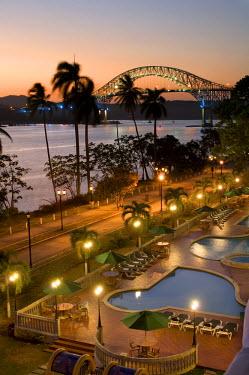 PN01112 Panama, Panama Canal, Bridge Of The Americas, Pacific Entrance, Amador Causeway, Hotel Swimming Pools, Dusk
