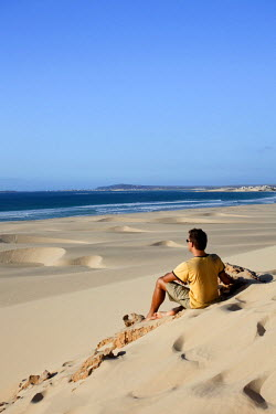 CV01107 Cape Verde, Boavista, Chaves Beach (Praia de Chaves), tourist on the sand dunes (MR)