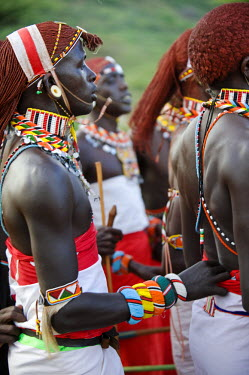KEN6667 Kenya, Laikipia, Ol Malo.  Samburu warriors sing, clap and dance in their traditional dress at a manyatta