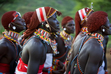 KEN6668 Kenya, Laikipia, Ol Malo.  Samburu warriors sing, clap and dance in their traditional dress at a manyatta
