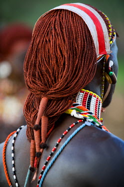 KEN6671 Kenya, Laikipia, Ol Malo.  A Samburu warrior's hair is ochred and tied up in braids at a dance at a local manyatta
