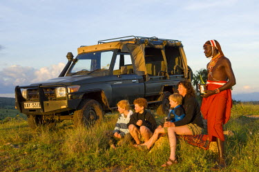 Kenya, Laikipia, Lewa Downs. A break for a sundowner during a game drive from Wilderness Trails. (MR)