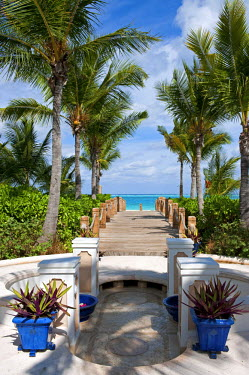 TAC0004 West Indies, Turks and Caicos Islands, Provodenciales. Pathway to the beach at Point Grace resort.