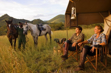 KEN6920 Kenya, Chyulu Hills, Ol Donyo Wuas.  Couple on a horse riding safari with Ride Africa in the Chyulu Hills (MR)