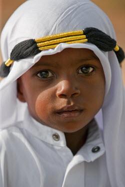 KEN6556 Kenya. A Muslim boy from Lamu with eye make-up for Maulidi, celebration of Prophet Mohammed�s birthday.
