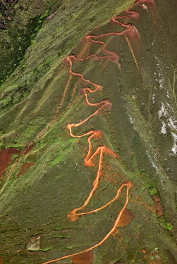 PER33360 Peru. A trail zigzags up a steep ridge on the Andean Mountains east of Cusco.
