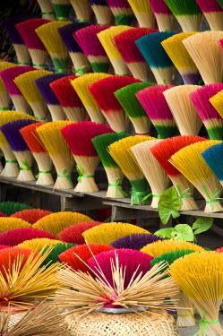 AS38_CMI0444 Vietnam, Da Nang. Old imperial capital city of Hue. Colorful handmade incense sticks.