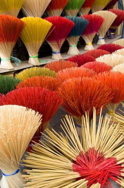 AS38_CMI0446 Vietnam, Da Nang. Old imperial capital city of Hue. Colorful handmade incense sticks.