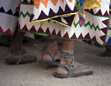SA13_LNO0215 Tehuerichi - Mexico. Feet of dancers celebrating Easter in Tehuerichi, a village in the Sierra Tarahumara. The sandals are made out of old tires.