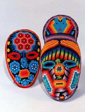 SA13_RGO0248 Mexico, Mexican traditional ethnic arts: Huichol Indian beadwork. The pieces all represent Huichol mythology.