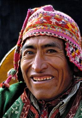 SA17_RER0026 Peru, Sacsayhuaman. A man dressed in a colorful Inca costume regards the camera warmly, in Inti Raymi, near Cuzco, Peru