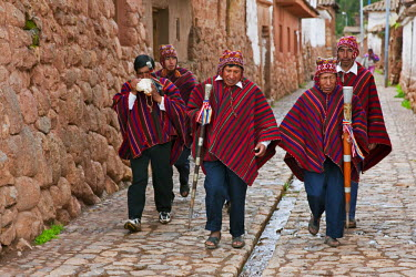 PER33436 Peru, Elected community representatives, some with staffs of office in hand, one blowing a conch shell, in Chinchero