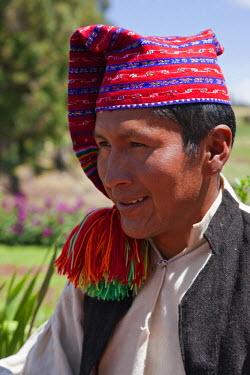PER33500 Peru, A Quechua-speaking man on Taquile Island wearing traditional dress.